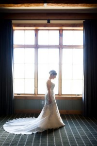 Custom wedding gown made from mothers wedding dress silhouetted by window