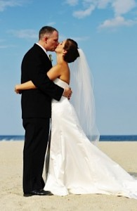 On beach wearing perfect wedding gown